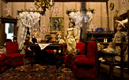 Dollhouse. Vintage ornate dollhouse with girl dolls Stock Photo