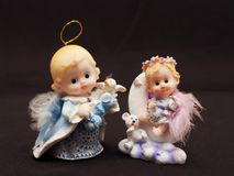 Dollish Angels. Small toy angels as a souvenir for an ornament Royalty Free Stock Photos
