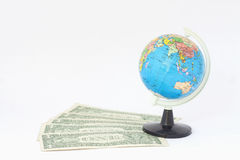 Dollor banknote and globe model on white background Stock Photo