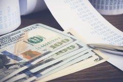 Dollor d'argent de billets de banque des USA et effets financiers Photo stock