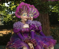 Dolls. Two colorful twin dolls in purple outfit Royalty Free Stock Photos