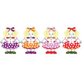 Dolls. Pastel colored four doll dresses Royalty Free Stock Images