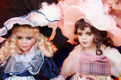 Dolls. Two old-looking dolls for sales Royalty Free Stock Photography