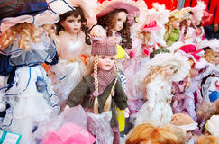 Dolls. Many old-looking dolls for sales Royalty Free Stock Image