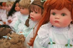 Dolls. Different Toy dolls in a row Royalty Free Stock Photography