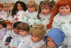 Dolls. Different Toy dolls in a row Stock Photos