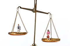 Dolls on Balancing Scales. Horizontally framed shot stock images