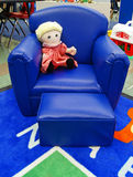 Dolls on the chair at daycare Stock Image