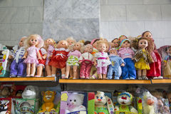 Dolls. children's toys. Dolls. fur toys for little girls and boys. store shelf toys royalty free stock photo