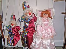 Dolls and clowns. And puppets on a string Stock Image