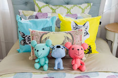 Dolls on colorful kid bed Royalty Free Stock Image