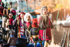 Dolls dressed in georgian national costumes. Traditional toys and figures of Georgians as souvenirs royalty free stock photography
