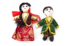 Azeri dolls. Dolls dressed with traditional azeri dress on a white background Stock Image