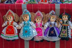 Dolls dressed in traditional Hungarian and Romanian folk costume stock image