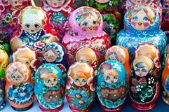 Dolls at a flea market in Piazza Santo Stefano royalty free stock photo