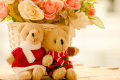 Dolls with flowers. On vintage background Royalty Free Stock Image