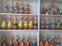 Dolls Galore. Beautiful dolls ready for sale in a royalty free stock image