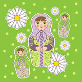 Dolls on a green field. Three Dolls on a green field among the daisies Stock Photos