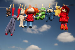 Dolls. Hanging to dry in the summer sun Royalty Free Stock Photos