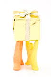 Dolls lift the box Royalty Free Stock Photo