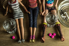 Dolls partying hard with alcohol, drugs and cigarettes. Royalty Free Stock Image