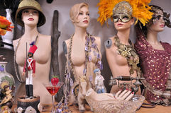 Dolls of props. Dummies of beautiful young women amongst  various artifacts  in the storage of props at the theater Royalty Free Stock Photo