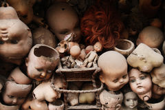 Dolls. Scary doll's heads (with some white dust spots Royalty Free Stock Photo