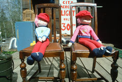 Dolls sitting on antique chairs, OR Royalty Free Stock Images