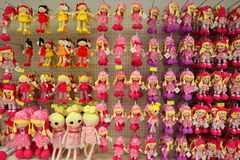 Dolls in a store. Dolls hanging on the wall in a store Stock Image
