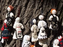 Dolls on a tree. Hanging dolls on a tree at a local fair royalty free stock images