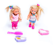 Dolls. Two dolls and a play set white royalty free stock photos