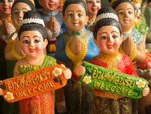 Dolls Wear Thai Costume Holding a Sign to Welcome royalty free stock photos