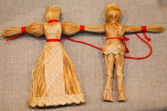 Dolls weaved from straw. Russian national souvenir Royalty Free Stock Photo
