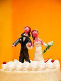 Dolls on wedding cake Royalty Free Stock Images