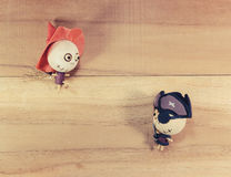 Dolls, witches and pirates on the wooden floor. Royalty Free Stock Image