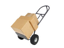 Dolly with Boxes. Heavy duty dolly with three shipping boxes Royalty Free Stock Image