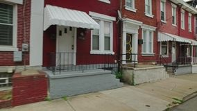 Row Houses on Pittsburgh`s Hill District. A dolly establishing shot of middle to low income row houses on Pittsburgh`s Hill District stock footage
