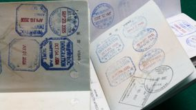 Many visa stamps. Dolly in on many visa stamps stock video