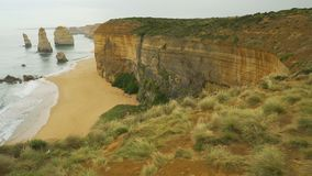 Dolly move in Twelve apostles in Australia on a cloudy and windy day stock footage
