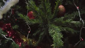 Dolly of ornaments on a Christmas tree stock video footage