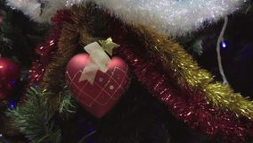 Dolly of ornaments on a Christmas tree stock footage