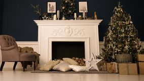 New Year`s Eve. Happy new year and christmas. A cozy room with fireplace, there is a Christmas tree decorated with toys stock image