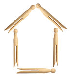 Dolly Pegs Arranged in House Shape Stock Photos