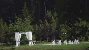 Dolly of rows of chairs at a wedding ceremony from the aisle.  stock video