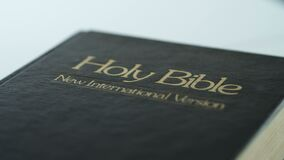 Dolly shot of black holy bible cover