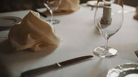 Dolly shot close up beautifully served expensive tableware warm tones stock video footage