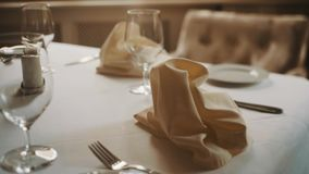 Dolly shot close up beautifully served table in restaurant warm tones stock video