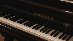 Dolly shot close up of black grand piano black and white keys stock video footage