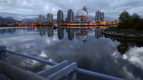 Dolly shot False Creek Dawn. A dolly shot of False Creek and the Vancouver skyline at dawn. British Columbia, Canada stock video footage