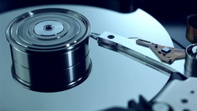 Dolly shot of Hard disk drive with spinning platter stock video footage